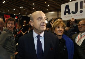 French politician Juppe of the conservative Les Republicains political party and candidate for the centre-right presidential primary and his wife Isabelle arrive for a rally in Lille