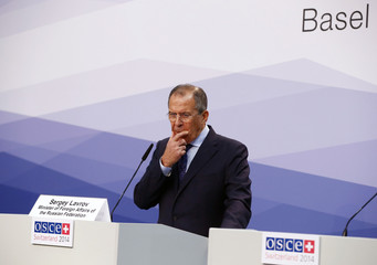 Russia's FM Lavrov gestures in a news conference during the OSCE meeting  in Basel