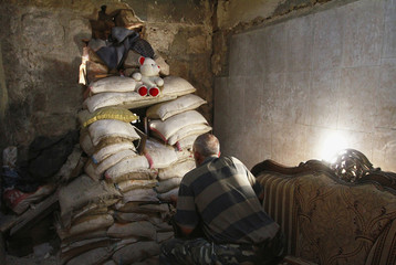 Free Syrian Army fighter takes position behind sandbags inside room in al-Jdeideh neighbourhood in the old city of Aleppo