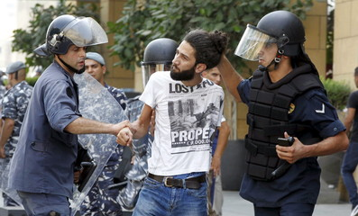 """Police forces detain an activist on a street leading to the parliament building where a session of """"national dialogue"""" is taking place between politicians aimed at discussing ways out of a political crisis, in downtown Beirut, Lebanon"""