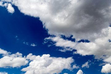 Beautiful clouds against blue sky as background