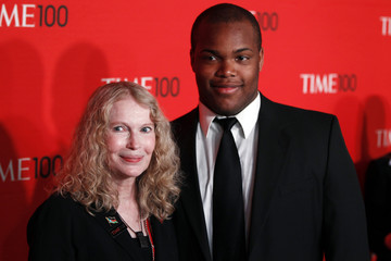 Actress Mia Farrow arrives with Isaiah Justus Farrow at the Time 100 Gala in New York