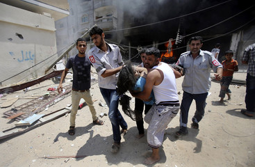 Palestinians evacuate a wounded girl following what police said was an Israeli air strike on a house in Rafah in the southern Gaza Strip