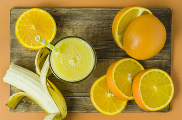 Orange and banana smoothie, top view