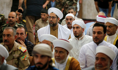 Worshippers, including senior military commanders and tribal sheikhs, attend the first Friday prayer sermon since the city's recapture at a mosque inside Falluja