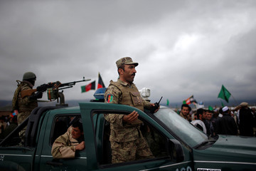 Security personnel keep watch during final day of campaigning by Afghan presidential candidate Abdullah Abdullah outside Kabul