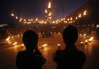 """People look at art installation on a quay, during """"Between Flames and Waves"""" event in Marseille"""