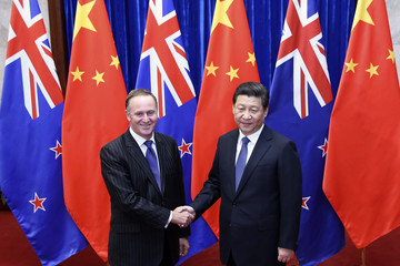 Chinese President Xi shakes hands with New Zealand's PM Key in Beijing