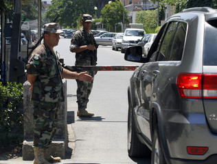Albanian army special forces stop a car for a security check at the entrance of a road leading to foreign embassies, ahead of Sunday's general election in Tirana
