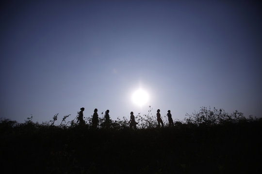 Forest guards are silhouetted as they patrol at Gir National Park and Wildlife Sanctuary in Sasan