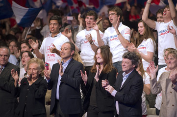 Ministers applaud during political rally for France's President and UMP party candidate for 2012 president elecction Nicolas Sarkozy in Paris