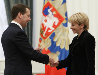 Russia's President Medvedev awards the Order of Friendship to Yelizaveta Glinka during a state awards ceremony at the Kremlin in Moscow
