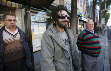 Spanish migrant del Paso waits for a bus in Madrid