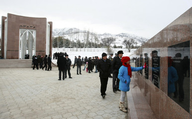 Visitors look at memorial complex dedicated to victims of the April 7, 2010 civil unrest in Kyrgyzstan, during complex's official opening in village of Chon-Tash