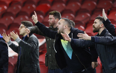 Fans gesture after the game