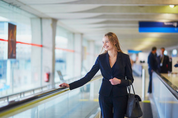 Woman on travelator in the international airport