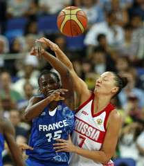 France's Digbeu and Russia's Kuzina jump for a rebound during their women's basketball semifinal match at the North Greenwich Arena during the London 2012 Olympic Games