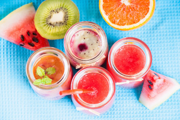 Jars with smoothies and fruits