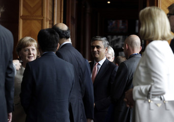 German Chancellor Angela Merkel and Deutsche Bank AG CEO Anshu Jain chat with representatives as they arrive for a gathering of the Christian Democratic Union party's (CDU) economic council in Berlin