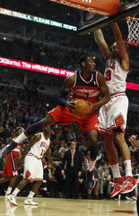Washington Wizards' John Wall goes to the basket against Chicago Bulls' Joakim Noah during their NBA basketball game in Chicago