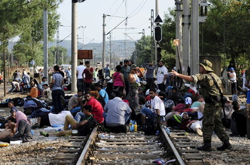 Macedonian special police guard the border as more than a thousand immigrants wait at the border line of Macedonia and Greece to enter Macedonia near the Gevgelija railway station