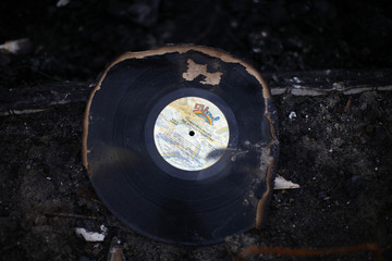 A record is seen in front of a home destroyed by a fire during Storm Sandy in the Breezy Point neighborhood of Queens, New York