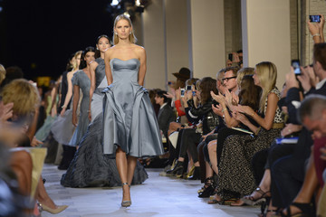 Models present creations from the Zac Posen Spring/Summer 2013 collection during New York Fashion Week