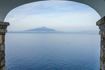 View of Vesuvio volcano with beautiful blue sea and sky in the sunset, southern Italy