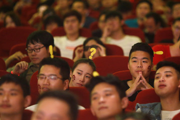 "Fans attend China's premiere of the film ""Warcraft"" at a theatre in Shanghai"