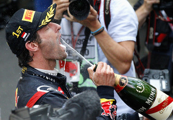 Red Bull Formula One driver Webber of Australia drinks champagne after winning the Monaco F1 Grand Prix