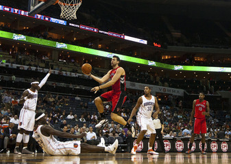 Raptors' Bargnani works to shoot the ball against the Bobcats during a NBA basketball game in Charlotte