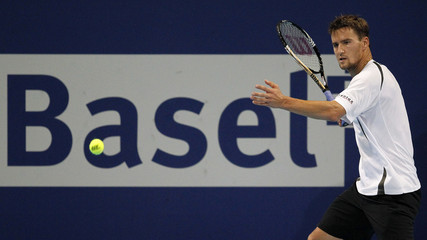Switzerland's Chiudinelli returns the ball to Dutch Haase at the Swiss Indoors ATP tennis tournament in Basel