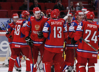 Russia's team players celebrate winning against Czech Republic after their 2012 IIHF men's ice hockey World Championship game in Stockholm