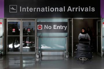 An international traveler arrives after U.S. President Donald Trump's executive order travel ban at Logan Airport in Boston