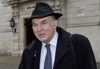 Britain's Liberal Democrat economy spokesman Cable leaves Millbank studios after giving radio and television interviews, in central London