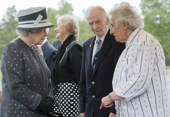 Britain's Queen Elizabeth speaks with Levy, Capt. Brown and Lasker-Wallfisch during a visit to the site of the former Nazi concentration camp Bergen-Belsen