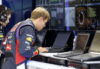 Red bull driver Sebastian Vettel of Germany checks the results of his practice during the first free practice of the Canadian F1 Grand Prix at the Circuit Gilles Villeneuve in Montreal