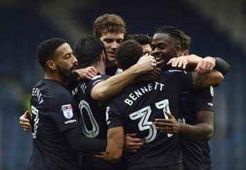 Blackburn Rovers' Sam Gallagher, Elliott Bennett and team mates celebrate their first goal scored by Queens Park Rangers' Joel Lynch (not pictured)