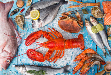 Wall Mural - Fresh tasty seafood served on old wooden table.