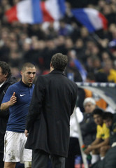 France's Benzema speaks with team coach Blanc as he leaves the pitch during an international friendly soccer match against Brazil at the Stade de France stadium in Saint-Denis