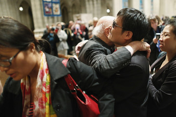 Chen receives hugs from well-wishers after he addressed the Ignatius Program at the National Cathedral in Washington