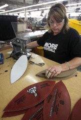 Angela Howard cuts leather for footballs at the Wilson Sporting Good dedicated football factory in Ada