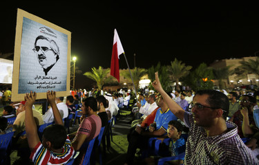 Demonstrators, hold a placard of political prisoner and Al Waad society president, Ebrahim Shareef, during an anti-government rally in the village of Saar