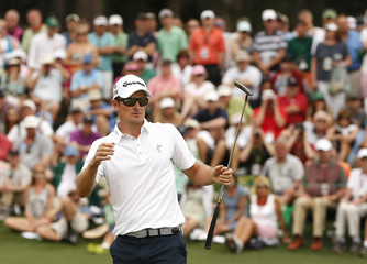 Justin Rose of Britain watches his eagle putt miss on the second hole during the final round of the Masters golf tournament at the Augusta National Golf Course in Augusta