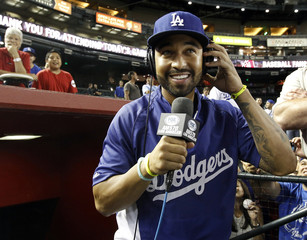 Dodgers' Kemp conducts a radio interview following the team's 9-3 victory over the Diamondbacks during their MLB National League baseball game in Phoenix