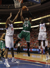 Boston Celtics' Pierce shoots between the defense of the Philadelphia 76ers' Young and Holiday during Game 3 of their NBA Eastern Conference semi-final playoff basketball game in Philadelphia