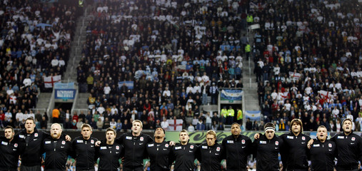England players line up during the playing of their national anthems before their Rugby World Cup Pool B match against Argentina at Otago Stadium in Dunedin