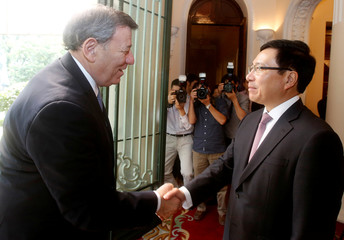 Uruguay's FM Novoa is greeted by Vietnam's DPM and FM Minh at the Government Guesthouse in Hanoi