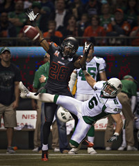 BC Lions cornerback Parks stops Saskatchewan Roughriders wide receiver Bagg from catching the ball during their CFL football game in Vancouver