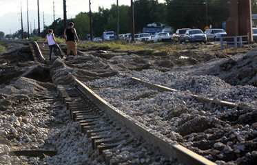 Railroad tracks are covered in flood debris and distorted in Longmont